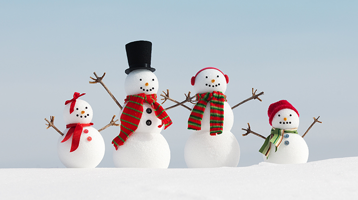 Family of snowmen waving.