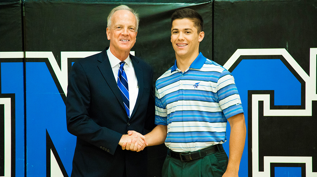 Photo of Senator Moran and Corbin Sanner