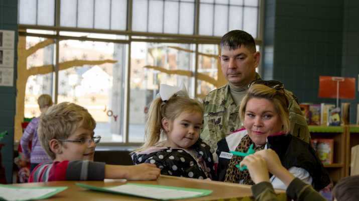 Military soldier with students.